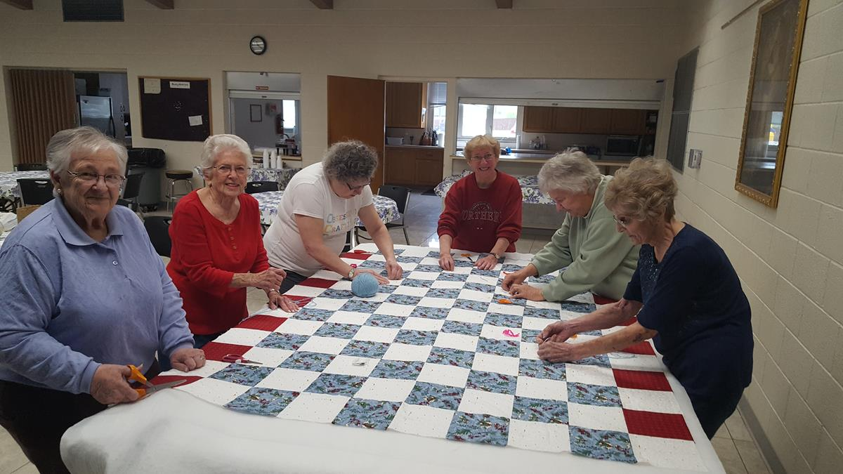 Dorcas Circle making quilts